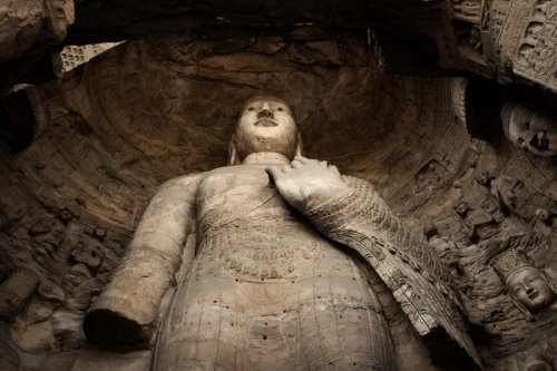 A nearly 50-foot Buddha is being restored. Credit Gilles Sabrie for The New York Times