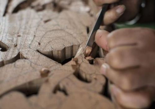 In 1997, having fled Tibet, Sampa Lhundup began a six-year apprenticeship in woodcarving.(Photo: Matt Wittmeyer)