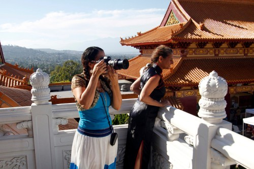 Sanrianha Cruz, a photographer from La Habra, takes pictures of the Hsi Lai Temples, during the Fo Guang Shan Hsi Temple Court Yard, Music and Art Festival, at the Hsi Lai Temple in Hacienda Heights, CA., Saturday, June 21, 2014. (Photo by James Carbone for the San Gabriel Valley Tribune)