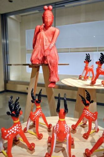 A Miroku-bosatsu Buddhist statue is surrounded by toy deer in the Nara Prefectural Museum of Art in Nara. (Kazuto Tsukamoto)