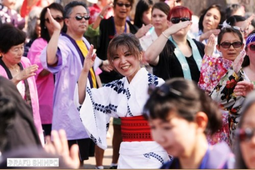 At last year's Bon Odori, dance instructor Roberta Cook of Santa Barbara Buddhist Church beams with happiness as she is surrounded by members of other churches and temples from around the Southland. (MARIO G. REYES/Rafu Shimpo)
