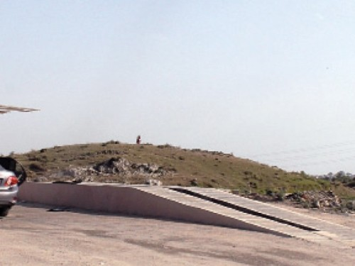 The mound is located in Sector E-11, next to the Pakistan Medical Cooperative Housing Society, Islamabad. PHOTO: EXPRESS