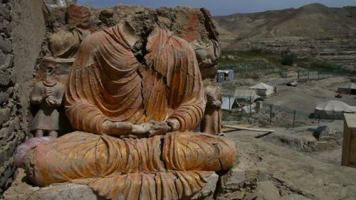 A Buddha statue discovered at the Mes Aynak archaeological site in the eastern province of Logar, in Afghanistan. The ancient city sits on top of one of the world's largest known copper deposits, which is currently on lease to a state-owned Chinese mining company. Brent Huffman