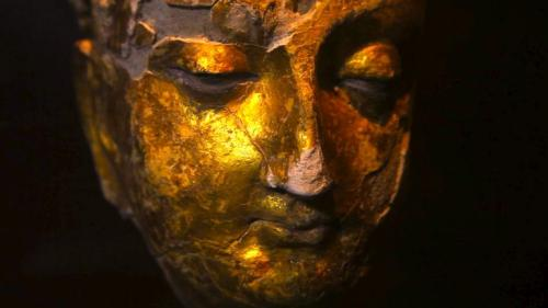 A gold-plated Buddha head is just one of many artefacts found at the Mes Aynak site, as archaeologists scramble to preserve what they can with limited time and resources. Brent Huffman