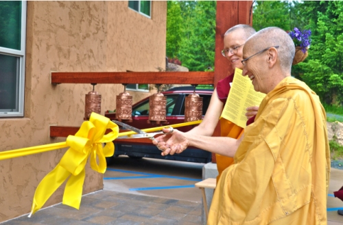 Abbess Ven. Thubten Chodron and Construction Manager Ven. Thubten Tarpa cut the ribbon together. Photos by: Sravasti Abbey.
