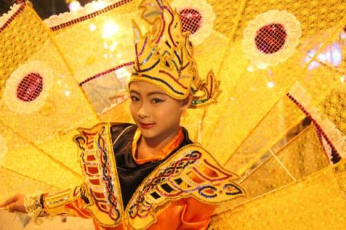 A young Shan girl performs the King Kala Bird dance.