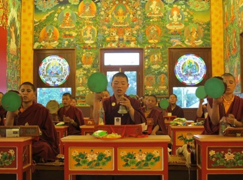 2015-01-30-00011.jpg The nuns of the Dongyu Gatsal Ling Nunnery surrounded by murals of the 21 Taras and stained glass windows depicting Taras by artist Tsunma Jamyang Donma of Yulokod Studios.
