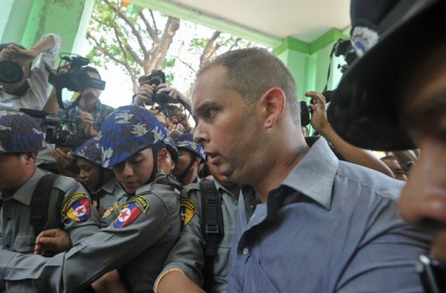 Philip Blackwood, a bar manager from New Zealand, leaving court on Tuesday. Mr. Blackwood and two Burmese men were sentenced to two years in prison in Myanmar for posting an image online of the Buddha wearing headphones to promote an event. Credit Soe Than Win/Agence France-Presse — Getty Images