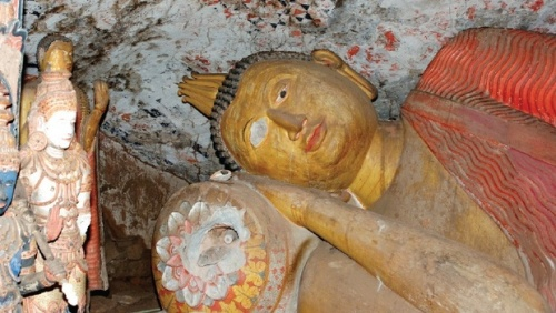 The reclining Buddha at Danagirigala which lost an eye and suffered other damage in 2005/photographs by Department of Archaeology Sri Lanka / dpa
