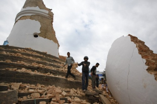 Volunteers work to remove debris at the historic Dharahara Tower in Kathmandu, Nepal. (Niranjan Shrestha/AP)