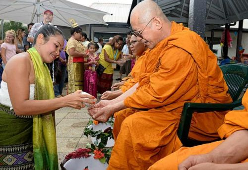 CELEBRATION: Chalee Kotsu, of Eureka, participating in the blessing by the Monks for the Thai New Year celebration in Lismore.