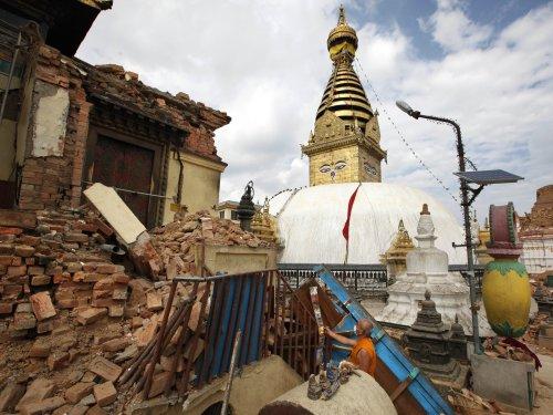 A Buddhist monk picks through a damaged monastery near the Swayambhunath stupa. Niranjan Shrestha/AP