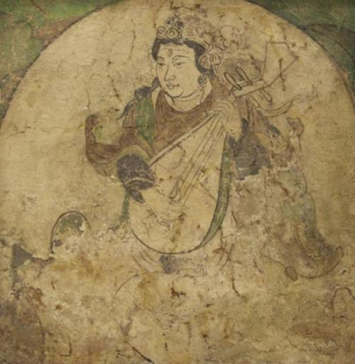 A feitian playing pipa, wall painting from Kizil, pigment on stucco, Tang dynasty, 600-800. Public Domain