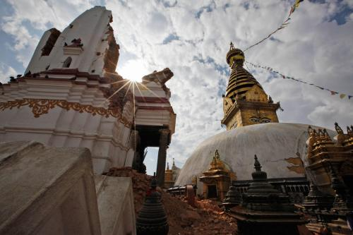 One of Nepal's oldest and most venerated shrines, the Swayambunath temple complex suffered damage in the April 25th and May 12th earthquakes. Conservators hope to shore up the main stupa before monsoon rains arrive.  PHOTOGRAPH BY NIRANJAN SHRESTHA, AP