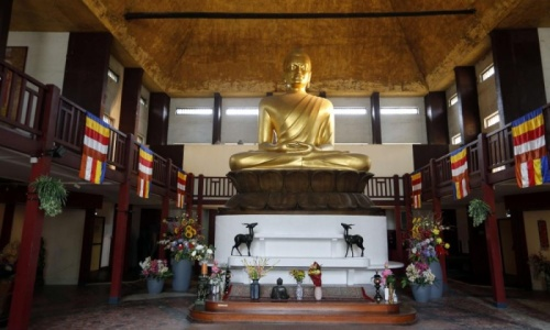 The golden Buddha statue inside the Grande Pagode. Photograph: Francois Guillot/AFP/Getty Images Kim Willsher