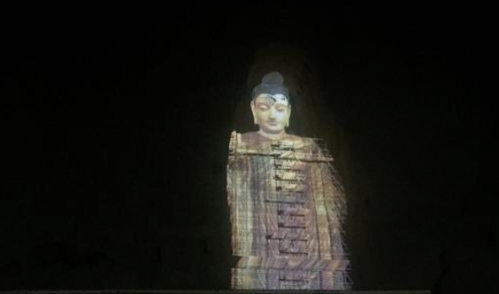 The historic Buddhas of Bamiyan statues have made a return to the Afghan valley as 3D light projections. Credit: Ali M Latifi