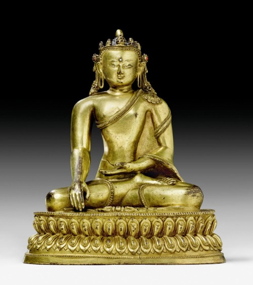 15th century, Nepal, Akshobhya (or crowned Shakyamuni), gilt copper and stone inlay, private collection.