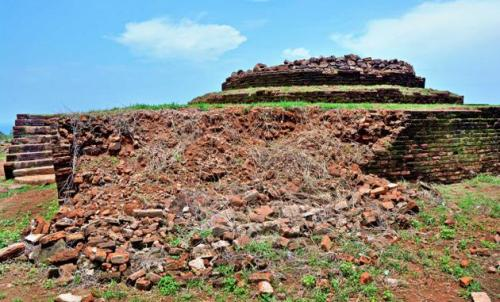 The damaged base of the main stupa at the Buddhist monument at Thotlakonda.— PHOTO: C.V. SUBRAHMANYAM