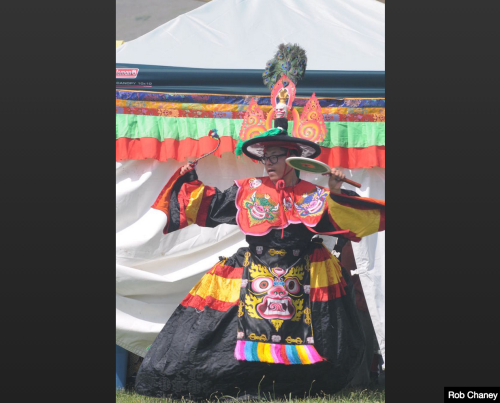 "A member of the Ewam Nyingma School of Tibetan Buddhism performs a ""Black Hat"" dance during the Tibetan Cultural Festival at the Garden of 1,000 Buddhas on Sunday in Arlee."