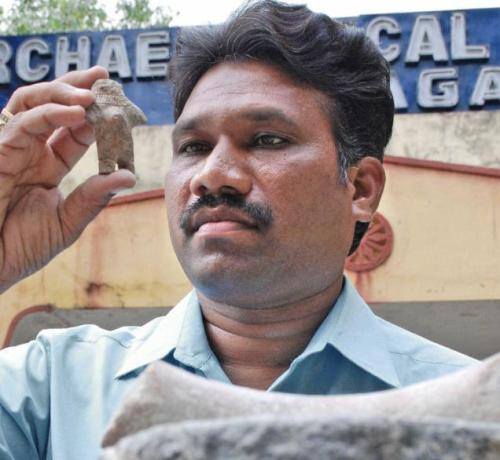 P. Nagaraju with a female figurine found near Pazzur village in Nalgonda district.