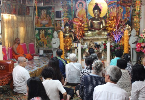 Worshippers inside the temple on Saturday. (Photo by Shannon Geis/Ditmas Park Corner)