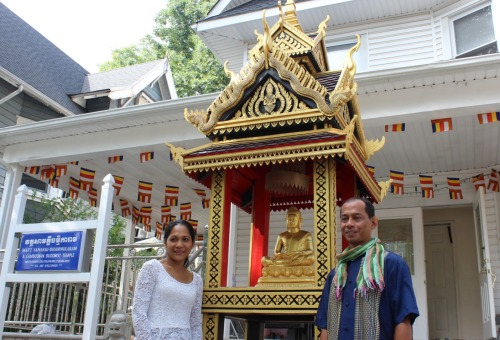 Savath Chan with the pagoda he built. (Photo by Shannon Geis/Ditmas Park Corner) The 12-foot-tall piece was constructed entirely by hand. Chan said he would work on it in his backyard for two or three hours every week.