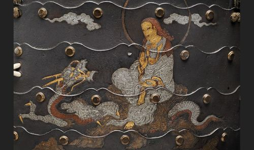 Detail of Samurai armour Cuirass with the Bodhisattva Kannon sitting on the dragon (Ryūzū-Kannon) Japan. 16th century Metal, leather, textile Musée d'ethnographie de Genève Photo : J. Watts