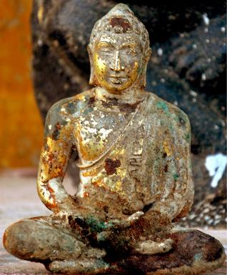A Buddha idol that was unearthed at Kanaparthi in Prakasam district on Tuesday.- Photo: by arrangement