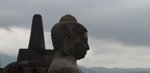 A huge Buddha statue overlooking the hills