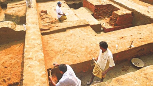 A team of the Department of Archaeology excavating a Buddhist temple with boundary walls, built 900 years ago, in Jaldhaka upazila of Nilphamari. The photo was taken recently. Photo: Star