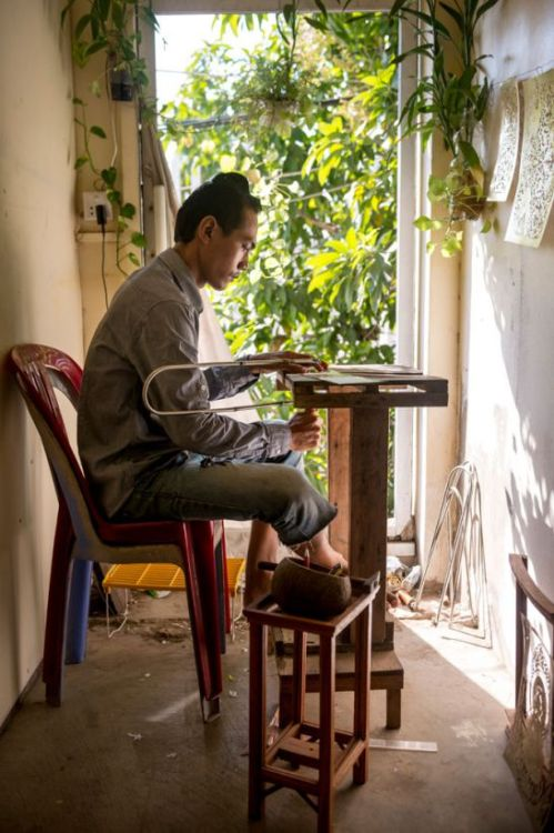 Content image - Phnom Penh Post Copper artist Sovann Vibol at work. scott rotzoll