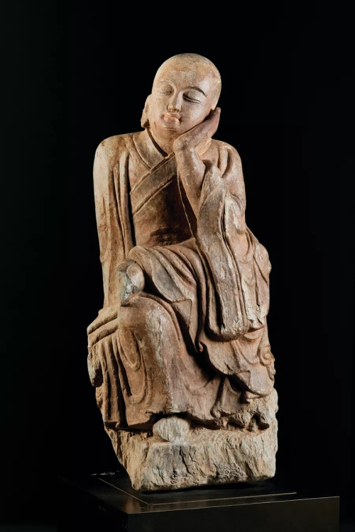 Seated young Arhat (Luohan), Chinese, 13th-14th century, limestone with paint (gift of Ira and Nancy Koger)