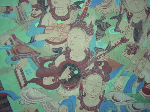A detail of a wall painting of musicians in cave 85, built in the Late Tang Dynasty (848-907 C.E.) photo credit: J. Paul Getty Trust