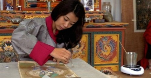 Princess Ashi Kesang is a picture of concentration as she practices the delicate art of restoring a thangka. Photo: HKEJ