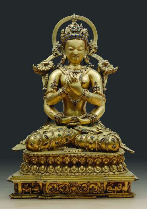 A 14th century gilt-bronze Tibetan sculpture depicts Prajnaparamita, the goddess of wisdom.