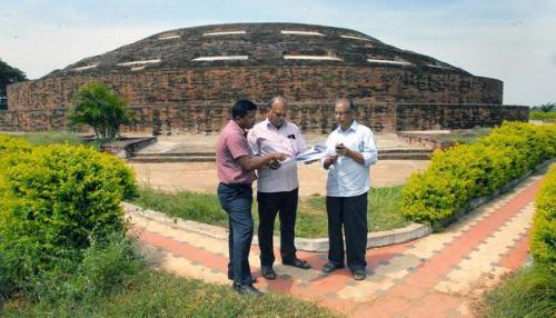 Restoring past glory:A team of the Archaeology and Tourism Department inspecting the Buddhist maha stupa at Nelakondapalli of Khammam district on Thursday.— PHOTO: G.N. RAO