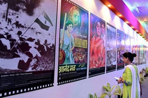 CINEMATIC TIMELINE: A visitor looks at posters at the multimedia exhibition in the 47 th edition of the International Film Festival of India in Panaji on Monday. — Photo: Atish Pomburfekar