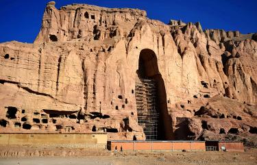 Afghan men walk at the site of the giant Buddha statues last month. The Buddhas were destroyed by the Taliban in 2001 in Bamiyan province. Photo: AFP/ Wakil Kohsar